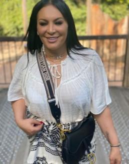 Diva Rebecca wearing Safe World Peace jewels