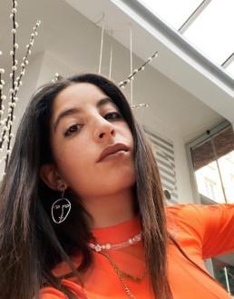 Selma Kacisebbagh wearing Safe World Peace jewels
